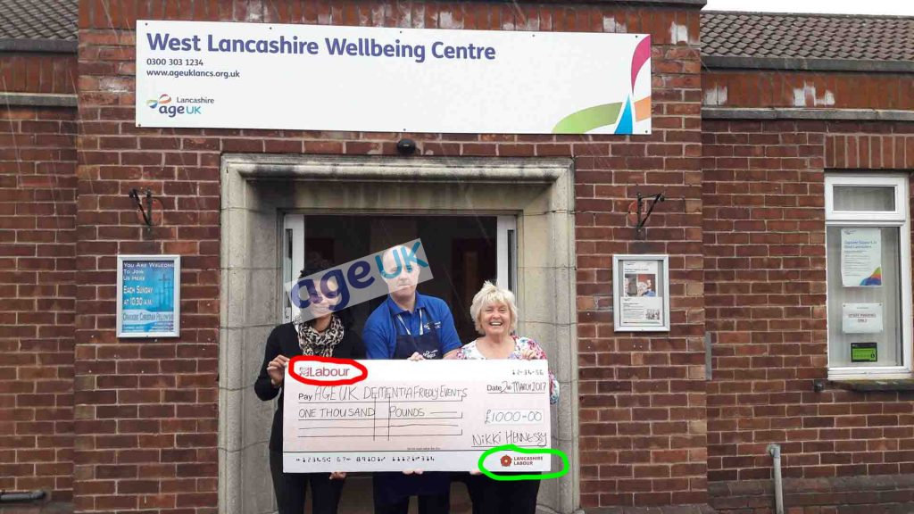 Nikki Hennessey presenting LCC funds as  a Labour cheque.