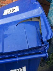 Jane's blue bin with a lid damaged by the collection wagon.