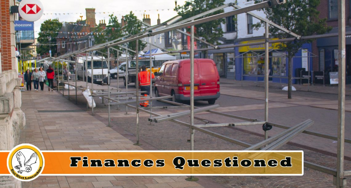 Ormskirk Market being disassembled by a worker in bright orange clothing
