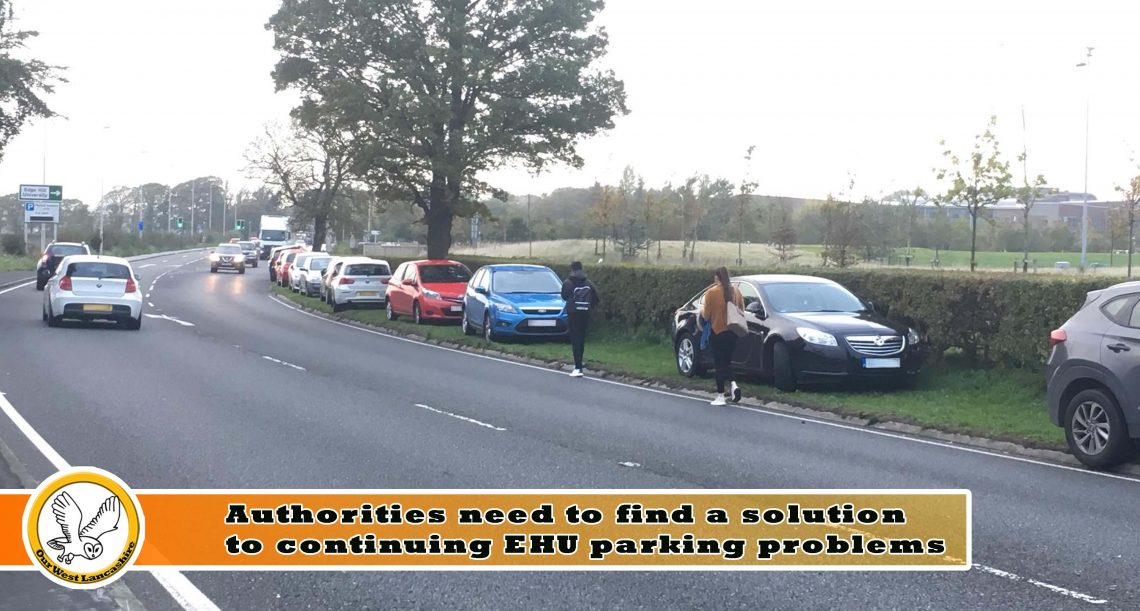 Image of cars parked on verges and pedestrians walking near traffic. Very dangerous.